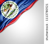 belize   flag of silk with... | Shutterstock . vector #1113780521