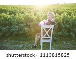 cute young blond girl sits on a ... | Shutterstock . vector #1113815825