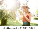 young pretty blonde spends time ... | Shutterstock . vector #1113816371