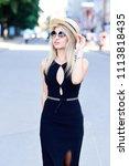 a beautiful blonde young girl... | Shutterstock . vector #1113818435