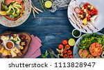 food. a set of delicious dishes ... | Shutterstock . vector #1113828947