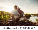 loving couple wrapped in plaid... | Shutterstock . vector #1113832577