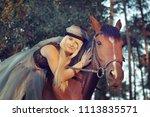 beautiful girl blond rider in... | Shutterstock . vector #1113835571