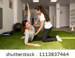 physical therapist assisting... | Shutterstock . vector #1113837464