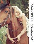 a beautiful sexy woman rider... | Shutterstock . vector #1113845909