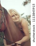 a beautiful sexy woman rider... | Shutterstock . vector #1113845915