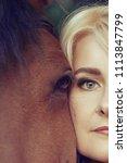close up face of a blonde woman ... | Shutterstock . vector #1113847799