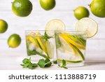 lemon drink on the wooden table. | Shutterstock . vector #1113888719