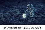 astronaut on the moon. mixed... | Shutterstock . vector #1113907295