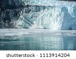 glacier is melting and dropping ... | Shutterstock . vector #1113914204