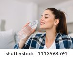 girl drinking water. girl in...   Shutterstock . vector #1113968594