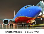 Southwest Airlines airplane at the departing gate at night - stock photo