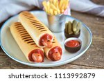 french hot dog with ketchup ... | Shutterstock . vector #1113992879