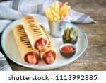 french hot dog with ketchup ... | Shutterstock . vector #1113992885