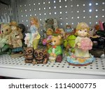 Small photo of Ceramic figurines on a shelf in a resale shop