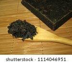 brick of pu erh tea and wooden... | Shutterstock . vector #1114046951