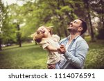 father and daughter at park... | Shutterstock . vector #1114076591