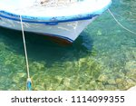 small fishing boats anchored in ... | Shutterstock . vector #1114099355