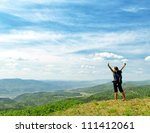young hiker on the hilltop. | Shutterstock . vector #111412061