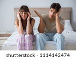 woman and man in the bedroom | Shutterstock . vector #1114142474