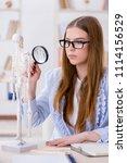 student sitting in classroom... | Shutterstock . vector #1114156529