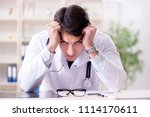 young doctor sitting in the... | Shutterstock . vector #1114170611