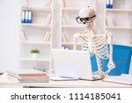 skeleton businessman working in ... | Shutterstock . vector #1114185041