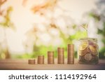 coins growing piggy bank with... | Shutterstock . vector #1114192964
