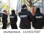 rear view of security guards in ... | Shutterstock . vector #1114217537