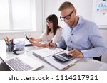 two young businesspeople... | Shutterstock . vector #1114217921