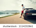 man solo traveler on cabriolet... | Shutterstock . vector #1114232861
