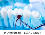 dentist cleaning teeth with... | Shutterstock . vector #1114243094