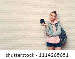 woman traveler photographer  | Shutterstock . vector #1114265651
