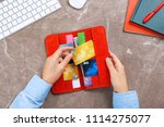Woman Holding Red Wallet With...