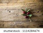 olives on olive branch. wooden...   Shutterstock . vector #1114284674