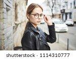 woman in glasses street style ... | Shutterstock . vector #1114310777