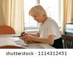 elderly woman plans her budget  ... | Shutterstock . vector #1114312451