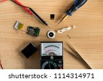 flatlay repair mp3 player on... | Shutterstock . vector #1114314971
