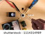 flatlay repair mp3 player on... | Shutterstock . vector #1114314989