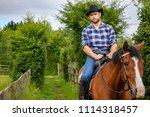 good looking  hunky cowboy... | Shutterstock . vector #1114318457
