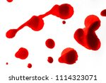 drops of blood on a white... | Shutterstock . vector #1114323071