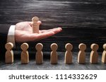 a businessman holds a wooden... | Shutterstock . vector #1114332629