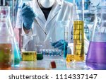 researcher pipetting samples in ... | Shutterstock . vector #1114337147