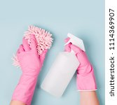 female hands cleaning on blue... | Shutterstock . vector #1114369907