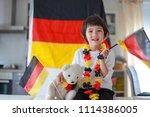 toddler boy waving flag... | Shutterstock . vector #1114386005