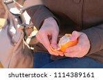close up woman's hands peels... | Shutterstock . vector #1114389161