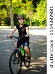 a boy on bicycle in the park | Shutterstock . vector #1114389881