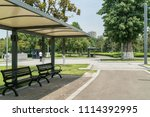 the road and the benches are in ... | Shutterstock . vector #1114392995