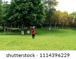 children are flying on the... | Shutterstock . vector #1114396229