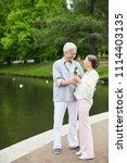 happy senior woman taking bunch ... | Shutterstock . vector #1114403135